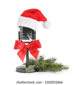 Retro microphone with Santa hat isolated on white. Christmas music concept