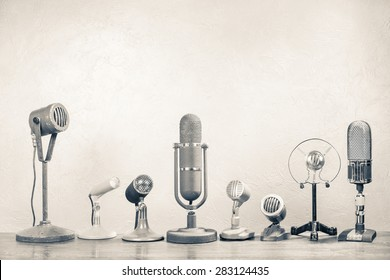 Retro microphones for press conference or interview. Vintage old style sepia photo