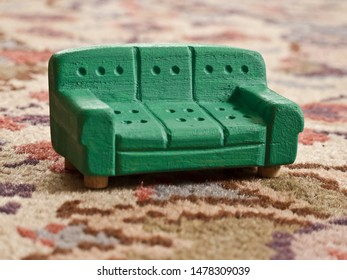 Retro miniature couch on the carpet.  Symbol of comfort.