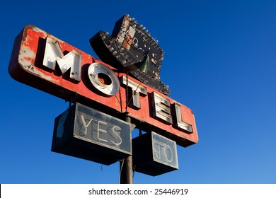 retro motel sign - abandoned motel against clear blue sky