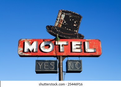 retro motel sign from an abandoned motel deep in rural US against clear blue sky