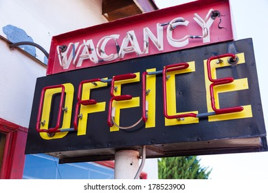 A retro neon vacancy office hotel sign