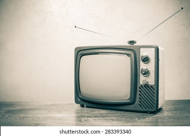 Retro obsolete TV from 70s. Vintage old style sepia photo