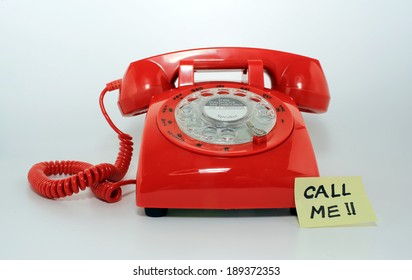 retro old fashion rotary dial phone closed with the memo call me