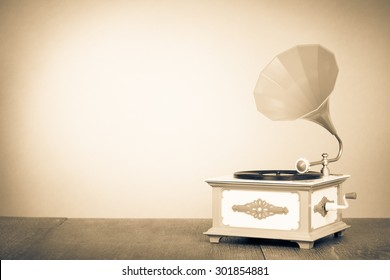 Retro old gramophone radio. Vintage style sepia photo