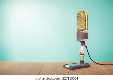 Retro old microphone front mint green background