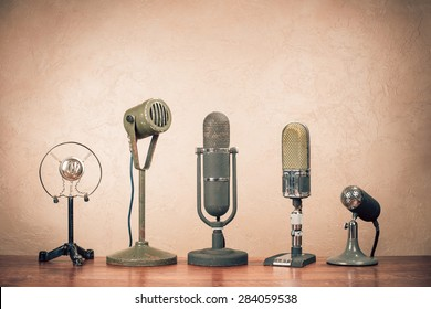 Retro old microphones for press conference. Vintage instagram style filtered photo