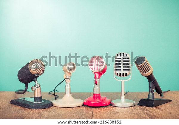 Retro old microphones for press conference or interview on table
