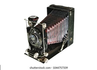 Retro old photografic camera. Isolated on white