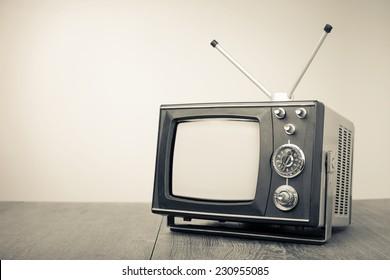Retro old portable television. Vintage style sepia photo