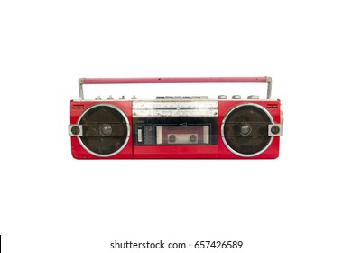Retro old red radio cassette tape recorder isolated on white background.