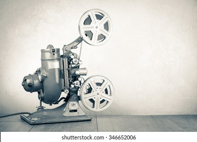 Retro old reel movie projector for cinema. Vintage style sepia photo
