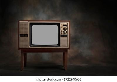 Retro old TV standing on a dark background