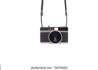 Retro, old, vintage and antique fashion manual film camera with strap made from silver steel metal, gray leather for negative color black & white object on isolated white background