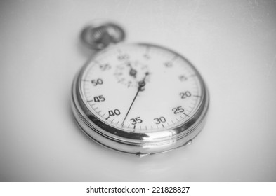 Retro old vintage stopwatch - aged background with grain noise texture