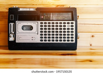 Retro oldschool design radio cassette tape recorder on wooden table