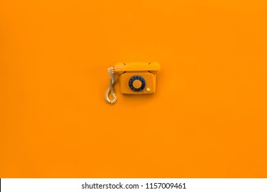 retro orange phone isolated on orange background