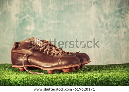 122627bd2 Retro outdated soccer or football spike boots. Vintage old style filtered  photo