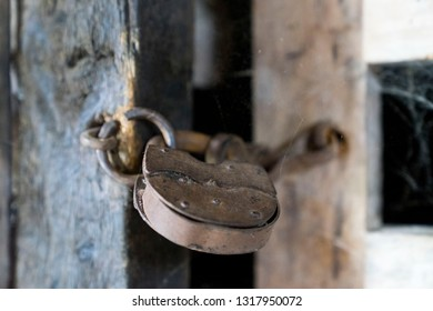 Retro padlock on a wooden door