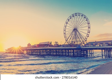 RETRO PHOTO FILTER EFFECT: Blackpool Central Pier at Sunset with Ferris Wheel, Lancashire, England UK