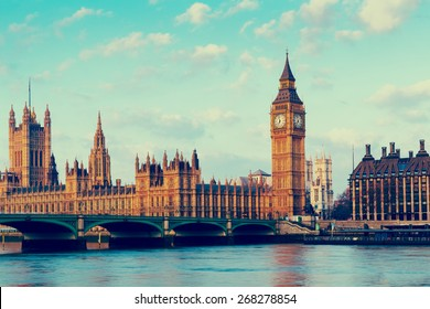 Retro Photo Filter Effect - Elizabeth Tower, Big Ben and Westminster Bridge in early morning light, London, England, UK