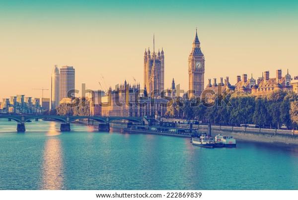 Retro Photo Filter Effect - Elizabeth Tower, Big Ben and Westminster Bridge in early morning light, London, England, UK.