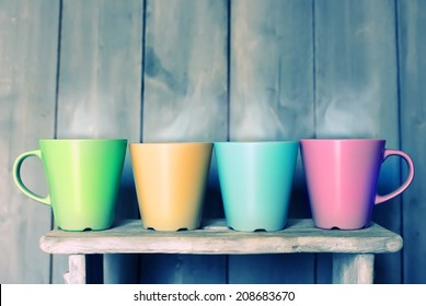 Retro photo of four cute tea  mugs