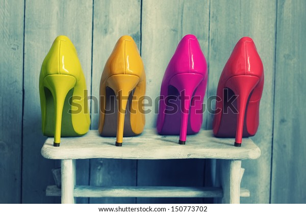 Retro photo of pink, yellow and red shoes