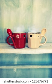Retro photo of two cute coffee cups