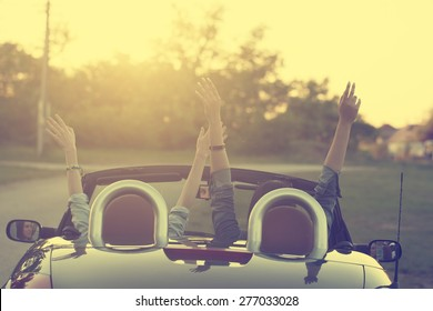 Retro photo of two happy traveler woman in cabriolet car