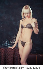 de370c61311 The retro photo of a vintage girl in underwear. vintage girl drinking a  morning cup