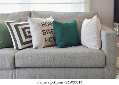 Retro pillows on the cozy grey sofa in the living room