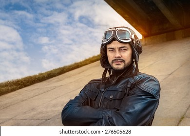 Retro Pilot Portrait with Glasses and Vintage Helmet - Image of a handsome and confident aviator man