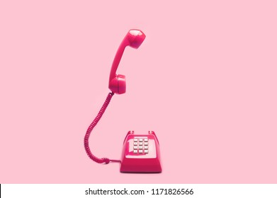 Retro pink telephone on pink background, Pop art or vintage style