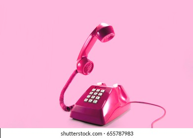 Retro pink telephone on pink background, Pop art style