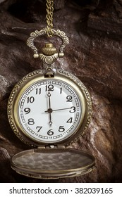 Retro pocket watch ancient on wood. vintage style. close up