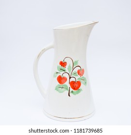 Retro porcelain jug with strawberry pattern isolated