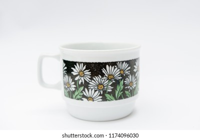 Retro porcelain mug with chamomille pattern isolated