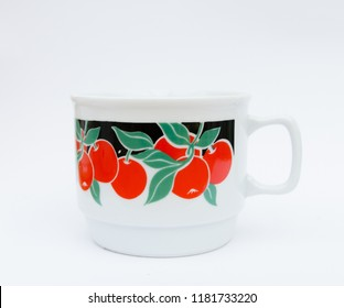 Retro porcelain mug with cherry pattern isolated