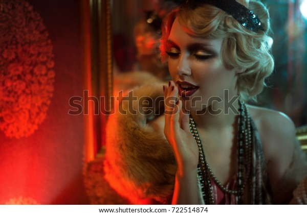 Retro portrait of a beautiful Gatsby woman. Vogue fashion style and smoke. Copy Space