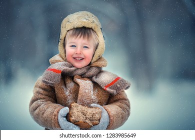 Retro portrait of a boy with a loaf of bread in Russia in winter. Image with selective focus and toning