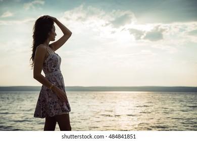 Retro Portrait of girl on the sea background. Outdoors, lifestyle. Europe, Adriatic Sea, Croatia.