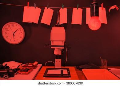 Retro print photos in the darkroom