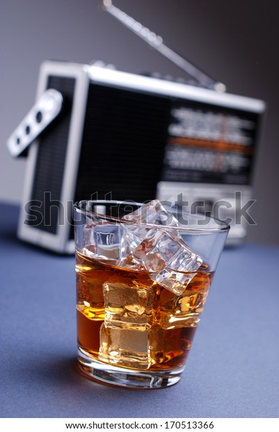 retro radio and a glass of whiskey with ice