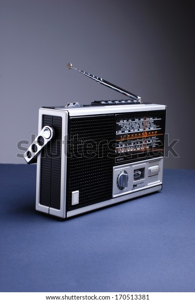 retro radio isolated on black table and gray background