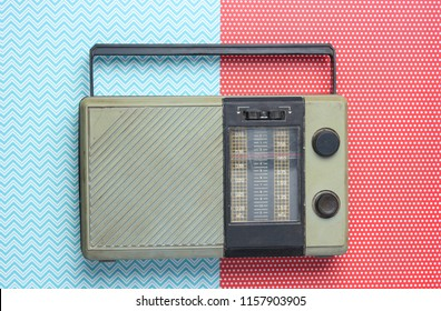 Retro radio receiver on creative background. Top view, minimalism