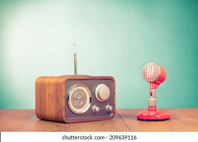 Retro radio and red microphone on table old style photo