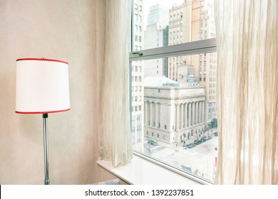 Retro red lamp by window view midtown New York City NYC cityscape in Manhattan hotel apartment condo high rise building