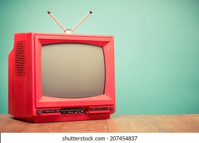 Retro red old television front mint green background