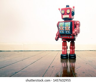 retro red robot on wooden floor with copy space
